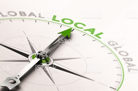 3D illustration of a compass with needle pointing the word local business. Concept of an ethical economy
